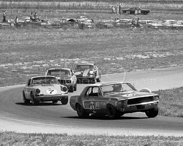 Tony Adamowicz in Porsche 7, on his way to the 1968 U2 Trans-Am driver's championship (unofficial) mixes it up with bigger boys at Continental Divide Raceway, CO