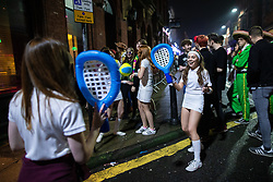 © Licensed to London News Pictures . 26/12/2018. Wigan, UK. A woman dressed as a tennis player on King Street . Revellers in Wigan enjoy Boxing Day drinks and clubbing in Wigan Wallgate . In recent years a tradition has been established in which people go out wearing fancy-dress costumes on Boxing Day night . Photo credit: Joel Goodman/LNP