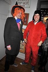 Left to right, EDWARD TAYLOR and ALEX GILKES at a party to celebrate the opening of Barts, Sloane Ave, London on 26th February 2009.