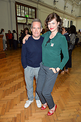 TOM HOLLANDER and JASMINE GUINNESS at a lunch in aid of the charity African Solutions to African Problems (ASAP) held at the Royal Horticultural Hall, Vincent Square, London on 19th May 2016.