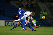 Mark Beevers  of Bolton Wanderers leap frogs over Kenneth Zohore of Cardiff city. EFL Skybet championship match, Cardiff city v Bolton Wanderers at the Cardiff city Stadium in Cardiff, South Wales on Tuesday 13th February 2018.<br /> pic by Andrew Orchard, Andrew Orchard sports photography.