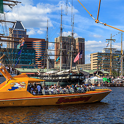 Baltimore, MD, USA - June 16, 2012: Loaded with sightseeing passengers, the Yellow Seadog in Baltimore's inner Harbor is ready to leave the dock for a tour.