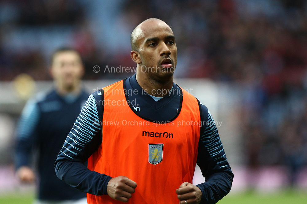 Fabian Delph of Aston Villa leaves the field after pre-match warm up. Barclays Premier league match, Aston Villa v Manchester Utd at Villa Park in Birmingham on Saturday 20th December 2014<br /> pic by Mark Hawkins, Andrew Orchard sports photography.