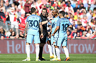 Craig Pawson, the referee, speaks to Fernandinho , Nicolas Otamendi (l) and Sergio Aguero ® of Manchester city.The Emirates FA Cup semi-final match, Arsenal v Manchester city at Wembley Stadium in London on Sunday 23rd April 2017.<br /> pic by Andrew Orchard,  Andrew Orchard sports photography.