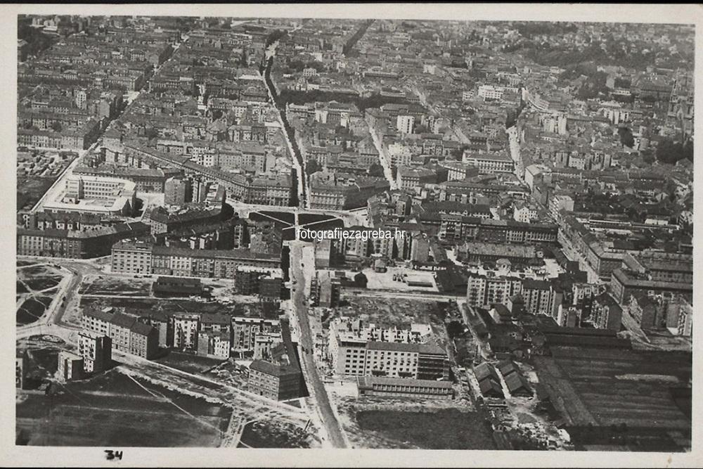 Zagreb : Istočni dio grada. U korist nabavke aeroplana. <br /> <br /> ImpresumZagreb : Foto-Material od t. t. Griesbach i Knaus, [19--].<br /> Materijalni opis1 razglednica : tisak ; 9 x 14 cm.<br /> NakladnikFotoveletrgovina Griesbach i Knaus (Zagreb)<br /> Mjesto izdavanjaZagreb<br /> Vrstavizualna građa • razglednice<br /> ZbirkaZbirka razglednica • Grafička zbirka NSK<br /> ProjektPozdrav iz Hrvatske<br /> Formatimage/jpeg<br /> PredmetZagreb –– Trg žrtava fašizma<br /> SignaturaRZG-PAN-5<br /> Obuhvat(vremenski)20. stoljeće<br /> NapomenaRazglednica nije putovala. • Sva prava pridržava Aeroklub Zagreb. Snimljeno iz zraka.<br /> PravaJavno dobro<br /> Identifikatori000952913<br /> NBN.HRNBN: urn:nbn:hr:238:367786 <br /> <br /> Izvor: Digitalne zbirke Nacionalne i sveučilišne knjižnice u Zagrebu