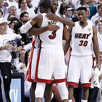 21 June 2012: Miami Heat shooting guard Dwyane Wade (3) is congratulated by Miami Heat guard Terrel Haris (14) during the Miami Heat 121-106 victory over the Oklahoma City Thunder, in Game 5 of the 2012 NBA Finals, at the AmericanAirlinesArena, Miami, Florida, USA. The Miami Heat wins the series 4-1.