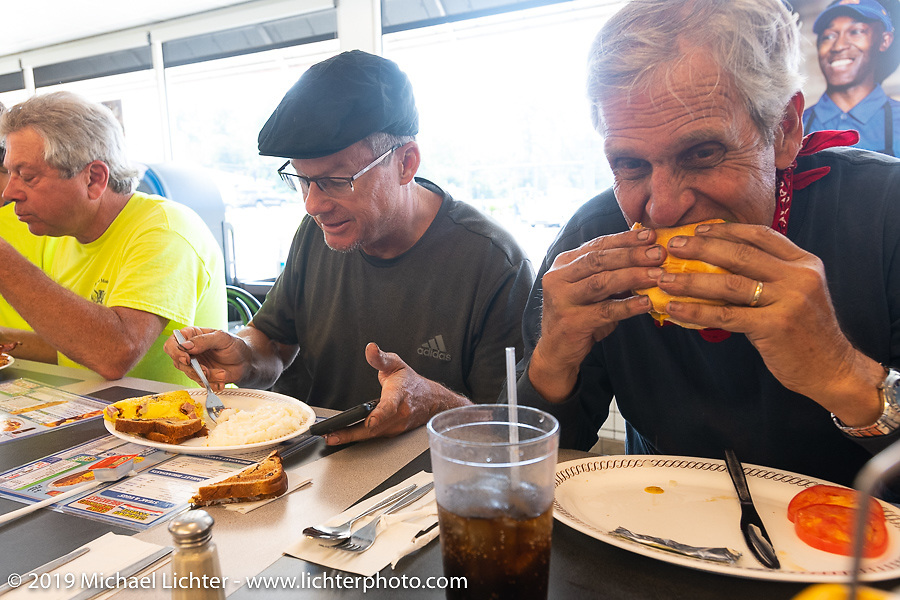 Larry Luce (R) and Todd Cameron stop for lunch at a Waffle House during the Cross Country Chase motorcycle endurance run from Sault Sainte Marie, MI to Key West, FL. (for vintage bikes from 1930-1948). Stage-7 covered 249 miles from Macon, GA to Tallahassee, FL USA. Thursday, September 12, 2019. Photography ©2019 Michael Lichter.