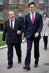 © licensed to London News Pictures. London, UK 24/02/2014. Mike Kane, newly elected Labour MP for Wythenshawe and Sale East arrives at the House of Commons with Ed Miliband following his by-election victory. Photo credit: Tolga Akmen/LNP