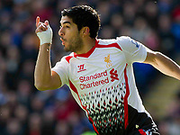 Football - 2013 / 2014 Premier League - Cardiff City vs. Liverpool<br /> <br /> Luis Suarez of Liverpool scores their ist gol at the Cardiff City Stadium.<br /> <br /> COLORSPORT/WINSTON BYNORTH
