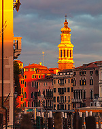 Tower above building in Venice in golden light at sunset time