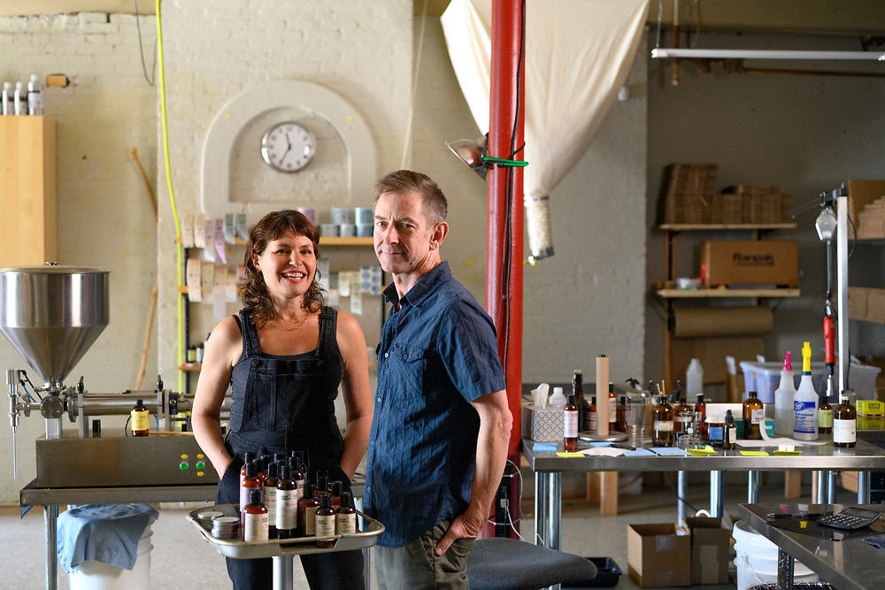 Baltimore, Maryland - May 20, 2021: Organic Chemistry founders Davina Grunstein and Alan Kolb are at the haircare product line's workshop in Hampden. <br /> CREDIT: Matt Roth for Baltimore Magazine