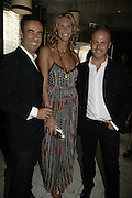 Francisco Costa, Elle MacPherson and Italo Zucchelli. Natalia Vodianova and Elle Macpherson host a dinner in honor of Francisco Costa (creative Director for women) and Italo Zucchelli (creative director for men)  of Calvin Klein. Locanda Locatelli, 8 Seymour St. London W1. ONE TIME USE ONLY - DO NOT ARCHIVE  © Copyright Photograph by Dafydd Jones 66 Stockwell Park Rd. London SW9 0DA Tel 020 7733 0108 www.dafjones.com