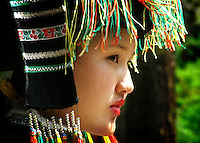 In south western China in the Yunnan Province lives an ethnic minority group called the Naxi. They are one of the last groups of people that use pictogrpahs.<br /> <br /> This girl sits at the steps of a temple waiting for tourists to arrive. Education and awareness are a cruicial way to ensure their traditions continue.
