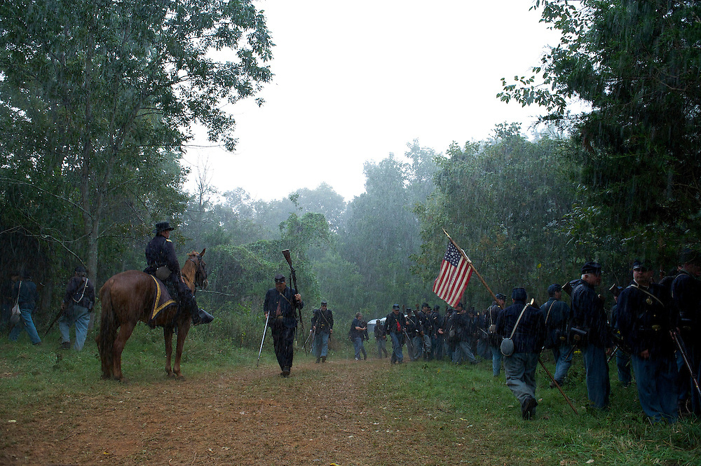 Union forces make their way to shelter when a downpour interrupts the 150th Antietam Civil War Reenactment.