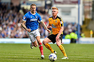 Portsmouth Midfielder, Carl Baker (7) and Cambridge United Midfielder, Liam O'Neil (16) during the EFL Sky Bet League 2 match between Portsmouth and Cambridge United at Fratton Park, Portsmouth, England on 22 April 2017. Photo by Adam Rivers.