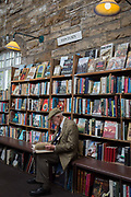 Surrounded by used books is an elderly gentleman reading a title the the shelves of the second-hand bookshop Barter Books in the Northumbrian town of Alnwick, on 26th September 2017, in Alnwick, Northumberland, England.
