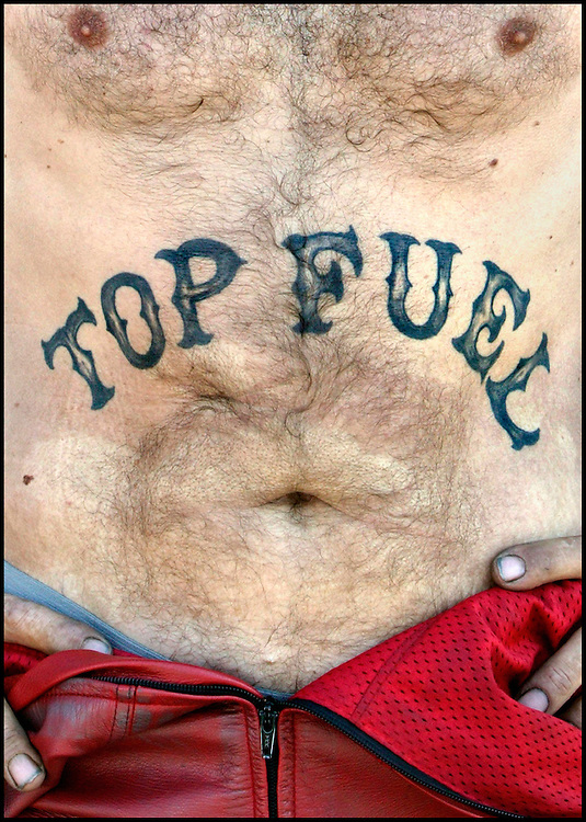 Germany, Hockenheim, 23-08-2003.<br /> Auto racing.<br /> Dragster race.<br /> Tattoo on the belly of a driver.<br /> Photo: Klaas Jan van der Weij.