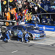 The pit crew changes tires on the car of Dale Earnhardt Jr. (88) during the 58th Annual NASCAR Daytona 500 auto race at Daytona International Speedway on Sunday, February 21, 2016 in Daytona Beach, Florida.  (Alex Menendez via AP)