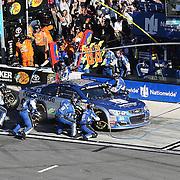 The pit crew changes tires on the car of Dale Earnhardt Jr. (88) during the 58th Annual NASCAR Daytona 500 auto race at Daytona International Speedway on Sunday, February 21, 2016 in Daytona Beach, Florida.  (Alex Menendez via AP)