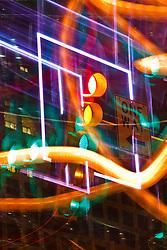 Streetlight framed against neon square, One Arts Plaza, Dallas, Texas, USA.