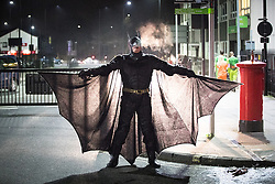 © Licensed to London News Pictures . 27/12/2016 . Wigan , UK . A man dressed as Batman . Revellers in Wigan enjoy Boxing Day drinks and clubbing in Wigan Wallgate . In recent years a tradition has been established in which people go out wearing fancy-dress costumes on Boxing Day night . Photo credit : Joel Goodman/LNP