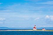 Little lighthouse on a little island of the coast of  Flower Cove, Newfoundland, Canada
