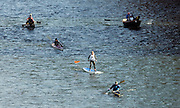 NEWS&GUIDE PHOTO / PRICE CHAMBERS.A full spectrum of water-born vessels navigate the flats of the Snake River between South Park Bridge and Astoria Bridge on Saturday during the Pole, Peddle, Paddle.