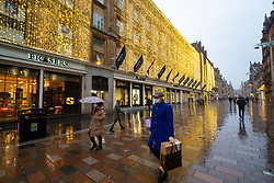 Glasgow, Scotland, UK. 1 November 2020. The Scottish Government today announced that from Friday 20 November, the most severe level 4 lockdown will be introduced in eleven Scottish council areas. This means non essential shops will close and bars, restaurants and cafes. Pictured; Shoppers walk past Christmas lights on Frasers department store on Buchanan Street. Iain Masterton/Alamy Live News