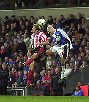 Photo. Glyn Thomas<br />Blackburn Rovers v Southampton. FA Barclaycard Premiership.<br />Ewood Park, Blackburn. 08-02-2003.<br />Southampton's James Beattie (L) battles for possession with Henning Berg