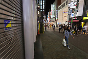 A Muslim woman, wearing a hijab, walks in Center Gai in the youth area of Shibuya, Tokyo, Japan. Thursday May 30th 2019