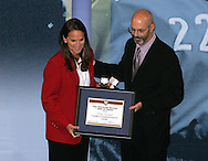 28 August 2006: Hall of Fame President/CEO Will Lunn (right) presents a plaque and ring to 2006 Hall of Fame inductee Carla Overbeck. The National Soccer Hall of Fame Induction Ceremony was held at the National Soccer Hall of Fame in Oneonta, New York.