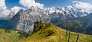"""From Wasenegg Ridge, see mountain peaks of Eiger (the Ogre, 13,026 feet), Mönch (the Monk), Jungfrau (the Virgin, 13,600 feet), and Lauterbrunnen Wall in the Berner Oberland, Switzerland, the Alps, Europe. The Bernese Highlands are the upper part of Bern Canton. Panorama stitched from 3 overlapping photos. UNESCO lists """"Swiss Alps Jungfrau-Aletsch"""" as a World Heritage Area (2001, 2007)."""