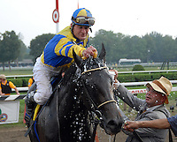 Calvin Borel cools off Street Sense after winning the Travers Stakes