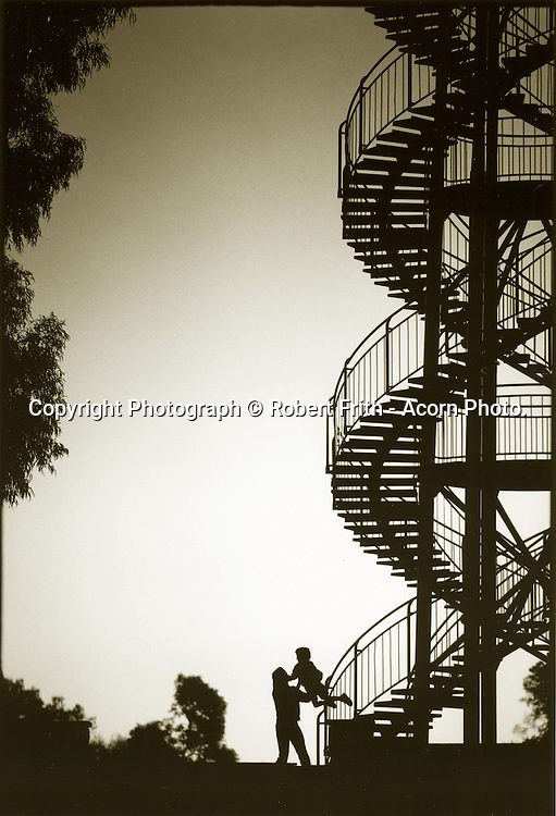 Mother and child at the DNA Tower in Kings Park. Built on the highest point of the park in 1966, the DNA Tower is a white 15m high double helix staircase that has 101 steps and was inspired by a double staircase in the Château de Blois in France. Its design resembles the deoxyribonucleic acid (DNA) molecule. The paving below the DNA Tower is made with stones sent from 11 towns and 80 shires in Western Australia.