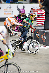 Kids had their own fun at the Flat Out Friday flat track racing on the Dr. Pepper-covered track in the UW-Milwaukee Panther Arena during the Harley-Davidson 115th Anniversary Celebration event. Milwaukee, WI. USA. Friday August 31, 2018. Photography ©2018 Michael Lichter.