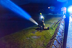 © Licensed to London News Pictures. 20/01/2021. Crickhowell, Powys, Wales, UK. Fire services pump out flooded properties in Crickhowell in Powys, UK.  After recent heavy rainfall the riverUsk bursts it's banks at Crickhowell, Powys, Wales, UK. Photo credit: Graham M. Lawrence/LNP