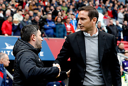 Bristol City manager Lee Johnson (left) and Derby County manager Frank Lampard shake hands prior to the beginning of the match