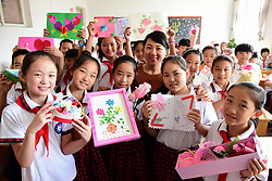 September 8, 2017 - Shijiazhuang, Shijiazhuang, China - Shijiazhuang, CHINA-8th September 2017: (EDITORIAL USE ONLY. CHINA OUT)..Pupils express greetings of Teacher's Day to their teacher at a school in Shijiazhuang, north China's Hebei Province, September 8th, 2017. (Credit Image: © SIPA Asia via ZUMA Wire)