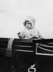 """File photo dated 03/05/1928 of Princess Elizabeth - daughter of the Duke and Duchess of York (later King and Queen of England) - waving from the carriage as she drives in London in 1928. The Duchess of Sussex gave birth to a 7lb 11oz daughter, Lilibet """"Lili"""" Diana Mountbatten-Windsor, on Friday in California and both mother and child are healthy and well, Meghan's press secretary said. Issue date: Sunday June 6, 2021."""