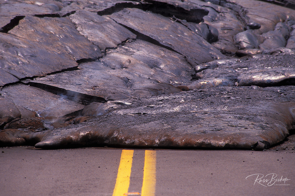 Detail of steaming lava covering Highway 137 in Kalapana, The Big Island, Hawaii