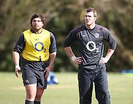 Alex Corbisiero (L) and TOm Croft (R) look on during the England elite player squad rugby training session at Pennyhill Park, Bagshot, Surrey, UK on 11 March 2011. The England team play Scotland on Sunday 13th March at Twickenham. (Photo by Andrew Tobin/Focus Images)