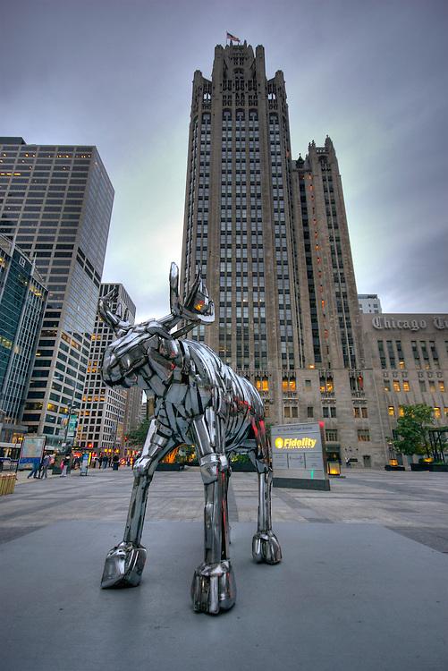 Traveling exhibit of Bernar Venet sculpture plaza near Tribune Tower coil of iron metal moose in Chicago.