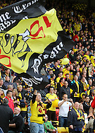 Watford fan and flag during the Sky Bet Championship match between Watford and Sheffield Wednesday at Vicarage Road, Watford, England on 2 May 2015. Photo by Phil Duncan.