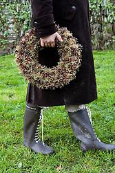 Sarah with fir cone wreath