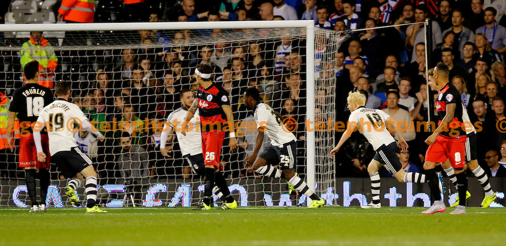 Moussa Dembele of Fulham wheels away after scoring the opener during the Sky Bet Championship match between Fulham and Queens Park Rangers at Craven Cottage in London. September 25, 2015.<br /> Carlton Myrie / Telephoto Images<br /> +44 7967 642437