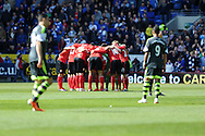 The Cardiff city team get in a huddle before the start. Barclays Premier league match, Cardiff city  v Stoke city at the Cardiff city stadium in Cardiff, South Wales on Saturday 19th April 2014. pic by Andrew Orchard, Andrew Orchard sports photography,