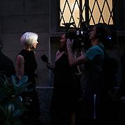 Terzo giorno della Settimana della Moda a Milano edizione 2013: intervista di una televisione privata in attesa della sfileta di Versace in Via del Gesù<br /> <br /> Third day of Milan fashion week 2013 edition: an interview of a private television waiting the Versace fashion show.