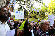 """October 11, 2011  The Occupy Wall Street protest, moved uptown  for a  Billionaires March""""  along 5th and Park  Avenues visiting  the  buildings of five of the city's wealthiest residents, including News Corp. CEO Rupert Murdoch, JPMorgan Chase CEO Jamie Dimon and conservative billionaire David Koch...Marchers presented the billionaires with oversize checks to dramatize how much less they will pay when New York State's 2% tax on millionaires expires in December."""