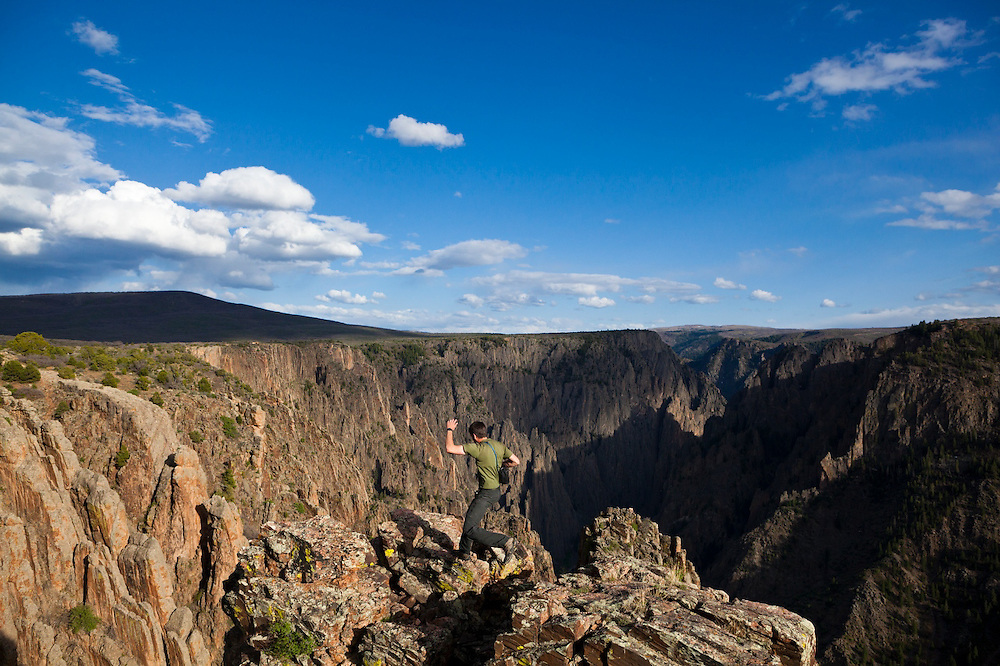 Obadiah Reid leaps out to the rim at Island Peaks, Black Canyon of the Gunnison National Park, Colorado.