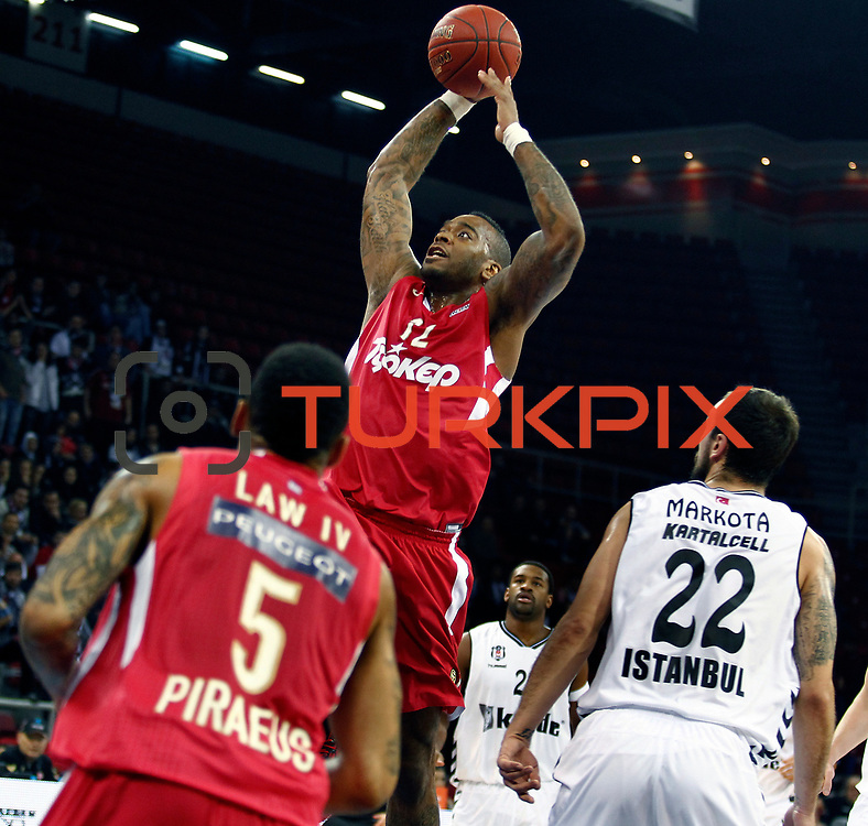 Olympiacos's Josh Powell (C) during their Turkish Airlines Euroleague Basketball Top 16 Game 9 match Besiktas between Olympiacos Piraeus at Abdi ipekci Arena in Istanbul, Turkey, thursday, February 28, 2013. Photo by Aykut AKICI/TURKPIX